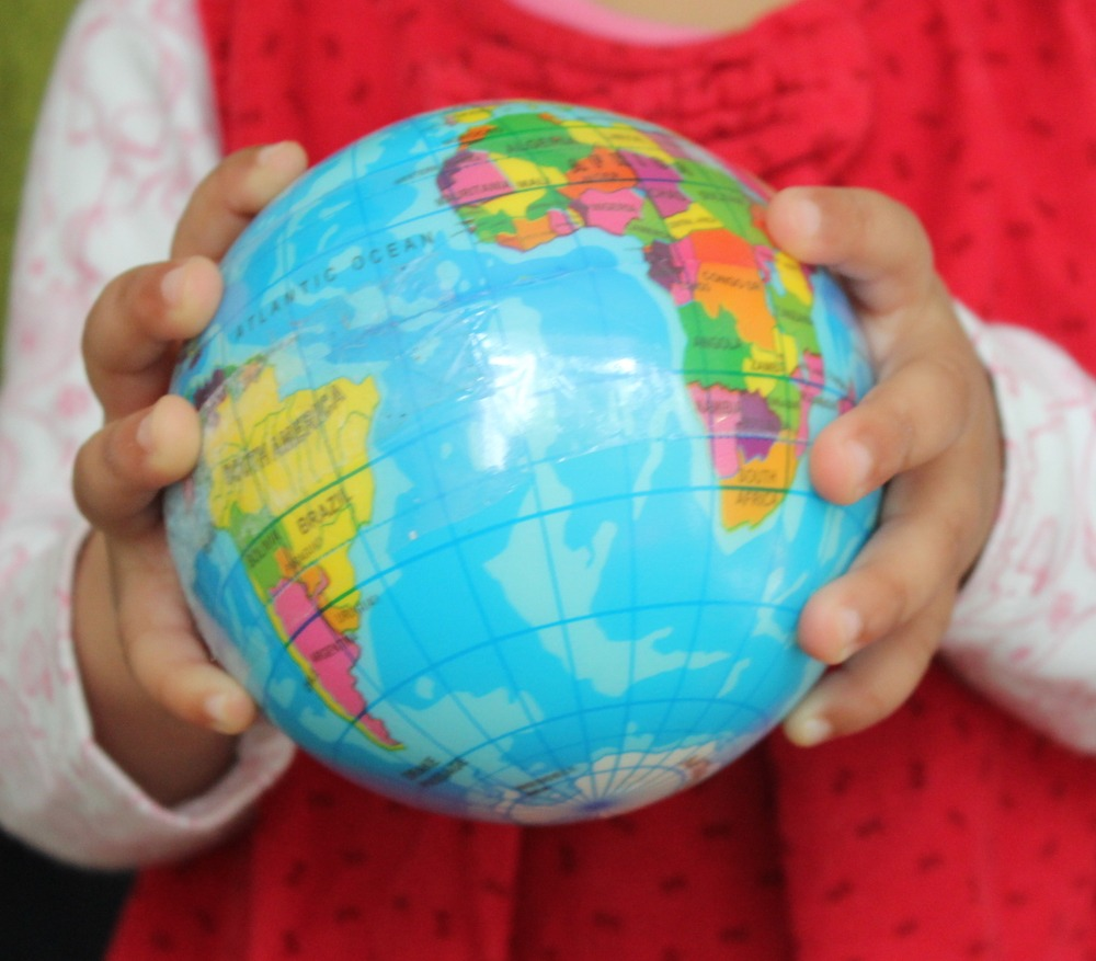 Earth Globe In Childs Hands